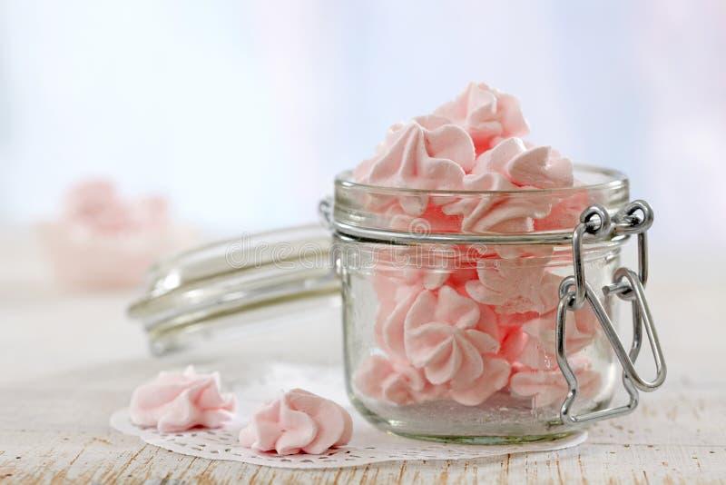 Pink meringue cookies. In jar stock image