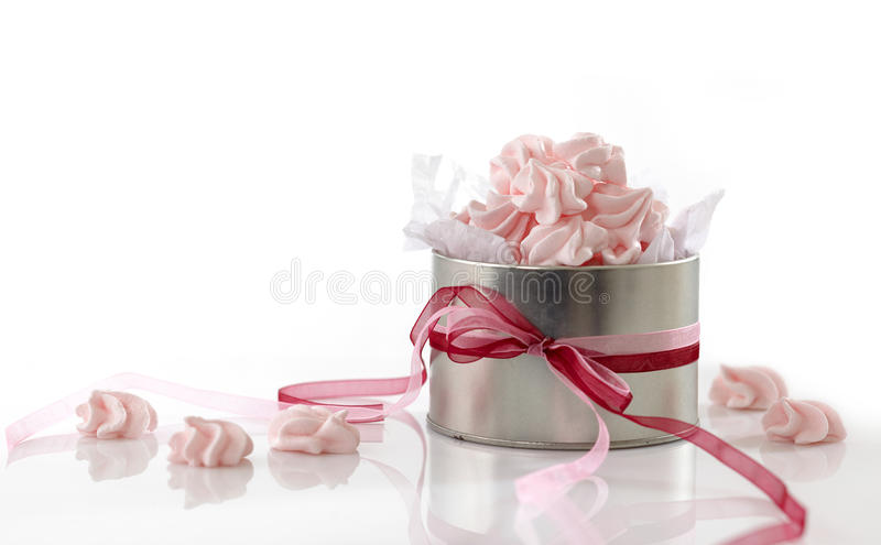 Pink meringue cookies. On white background royalty free stock photo