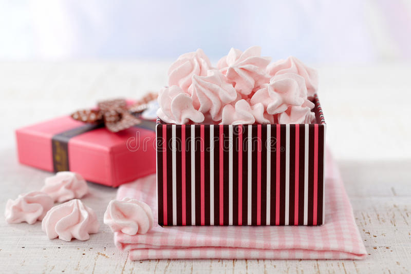 Pink meringue cookies. In gift box stock image