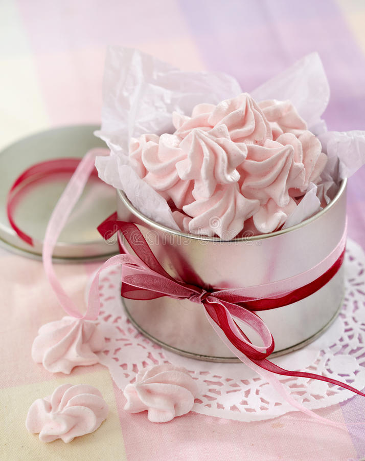 Pink meringue cookies. Close up of pink meringue cookies stock image