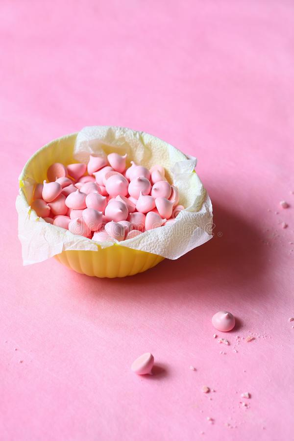 Pink Meringue Cookies in a bowl. On pink background royalty free stock photo