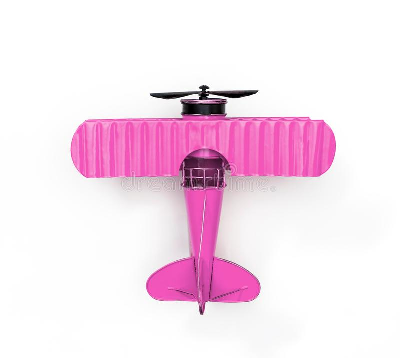 Pink Metal toy plane on white. Pink Metal toy plane isolated on white royalty free stock photo