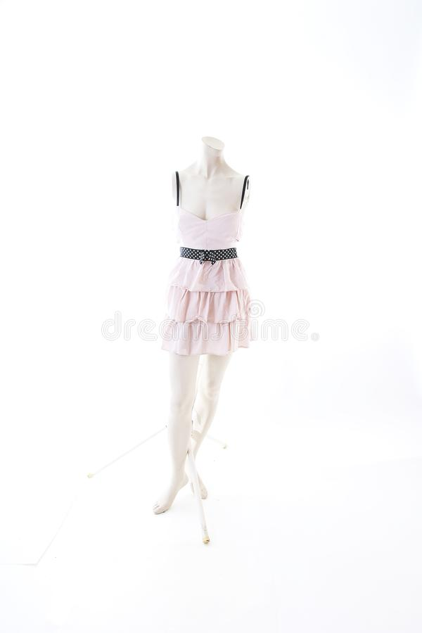Pink short mini dress on mannequin full body shop display. Woman fashion styles, clothes on white studio background. stock image