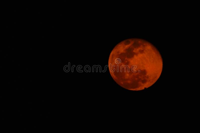Pink moon-View of full moon in April 2019, pink in colour stock images