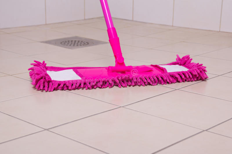 Pink Mop Cleaning Tile Floor In Bathroom Stock Image - Image of tile ...
