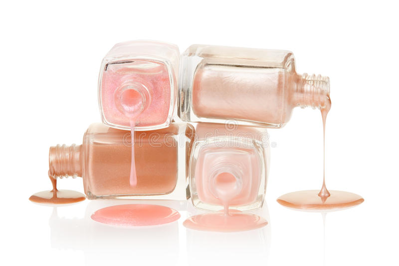 Pink nail polish spilled. On white background, clipping path included stock photos