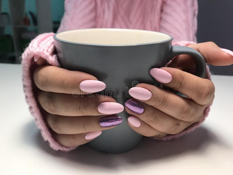 Pink nails with glitter in autumn or winter time royalty free stock image