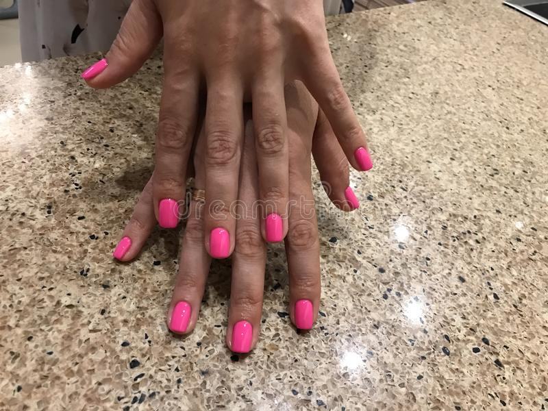 Pink nails manicure hands stock photography