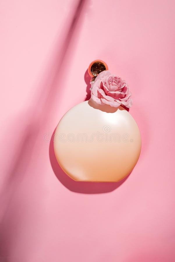 Pink natural cosmetic products gel, lotion, serum or toner roses on pink background. Pink natural cosmetic products with roses essential oil : gel, lotion, serum stock images