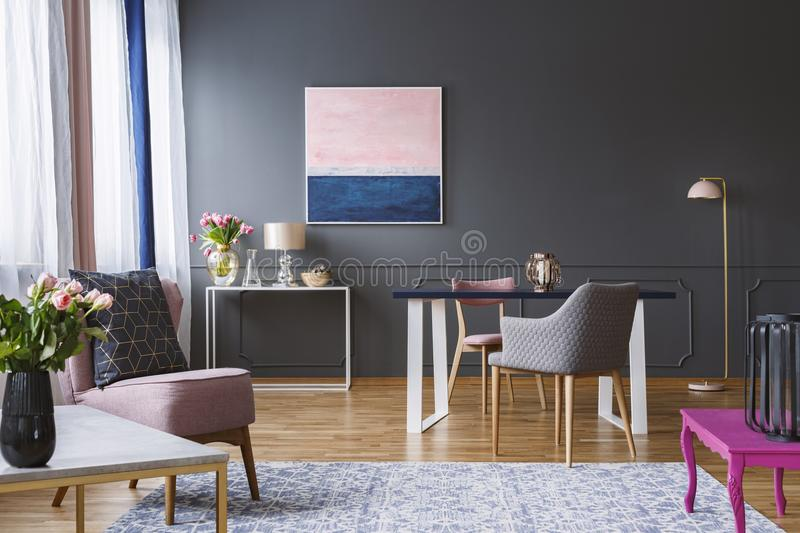 Pink and navy blue painting in grey living room interior with fl royalty free stock photography