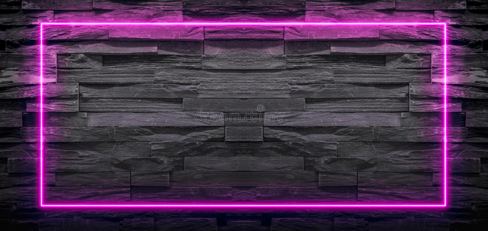 Pink neon light frame on stone background. Copy space for text or product display royalty free stock images