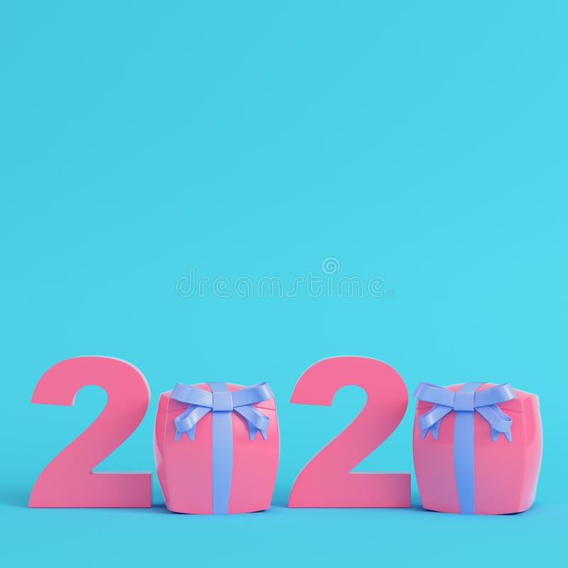 Pink new year 2020 figures with gift boxes on bright blue background in pastel colors stock photos