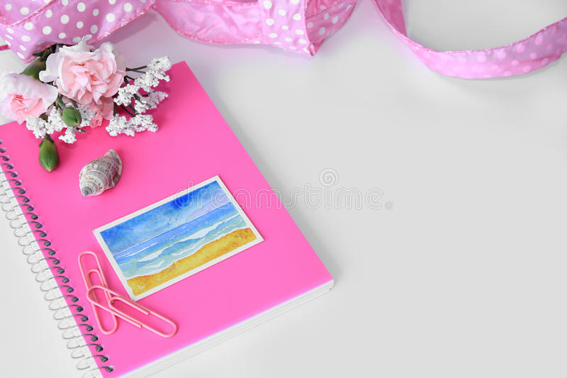 Download A Pink Notebook With A Miniature Beach Watercolor Painting. Stock Photo - Image: 68346292
