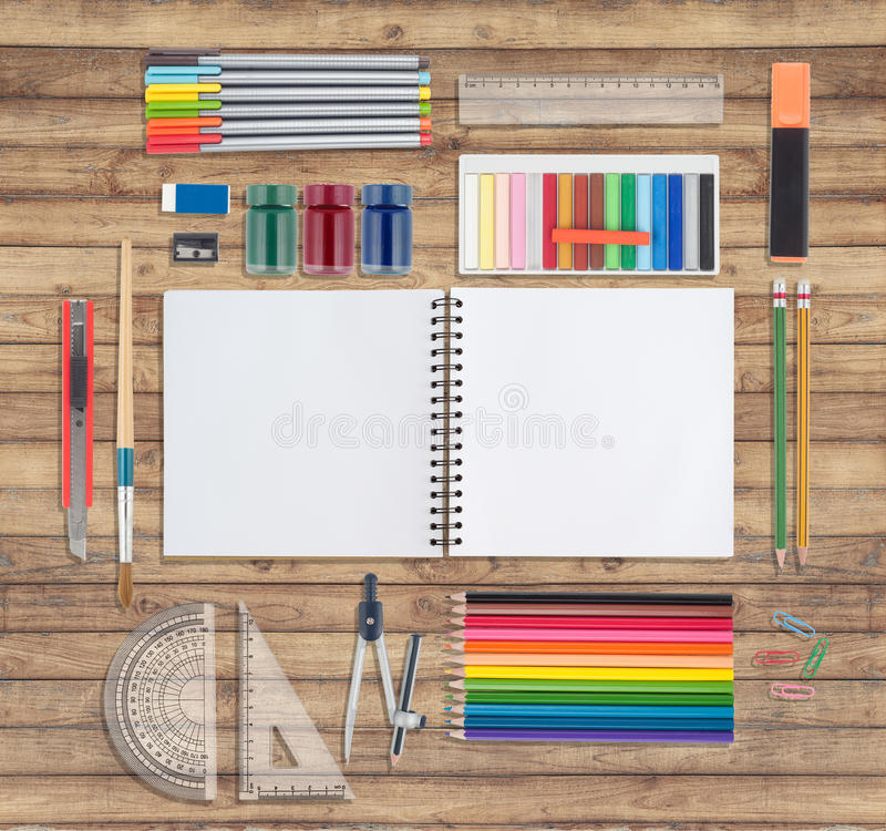 Pink notebook and school or office tools on wood background. When back to shcool stock photography