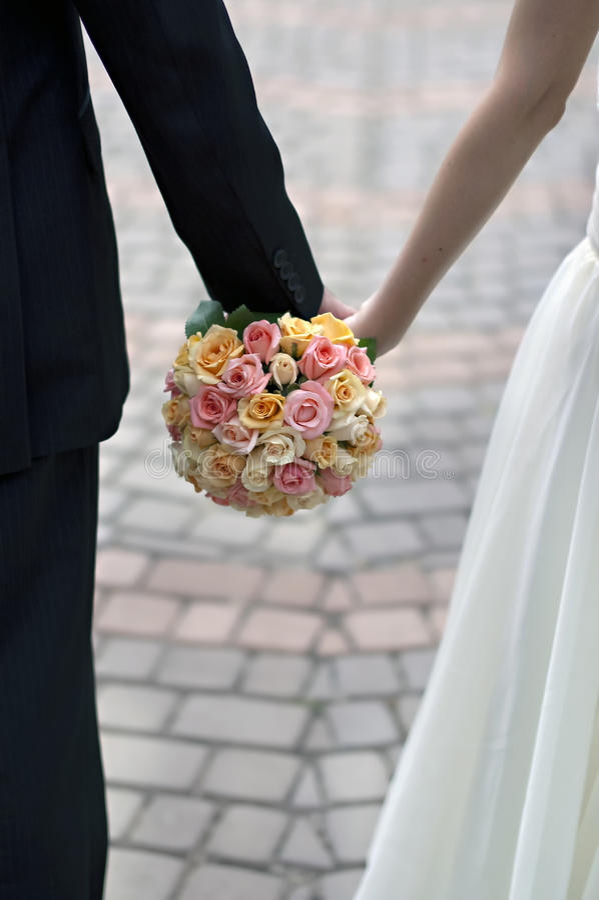 Pink, orange and white wedding bouquet stock photo