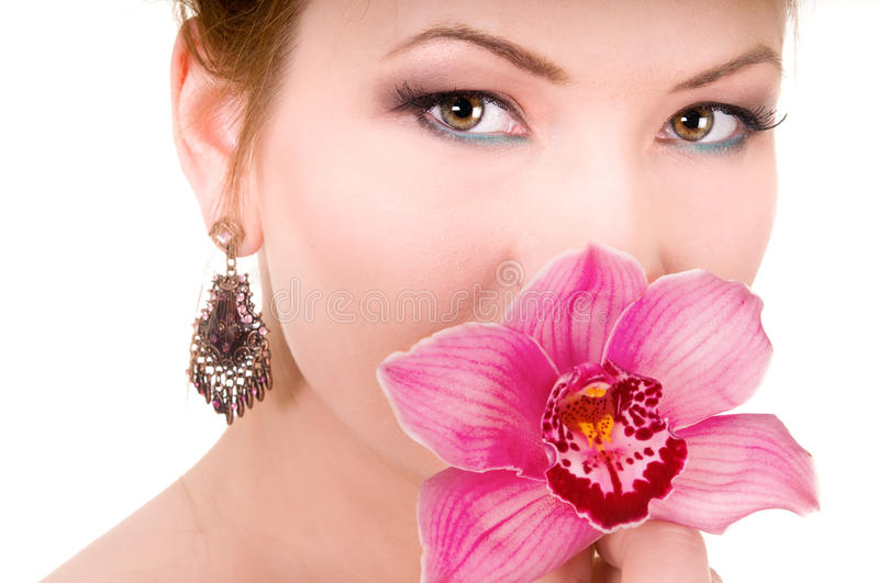 Pink Orchid and beauty woman. Pink Orchids and beauty woman on white background stock images