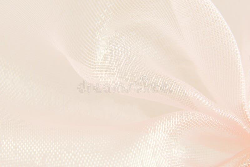 Pink organza macro blurry. Texture background stock photos