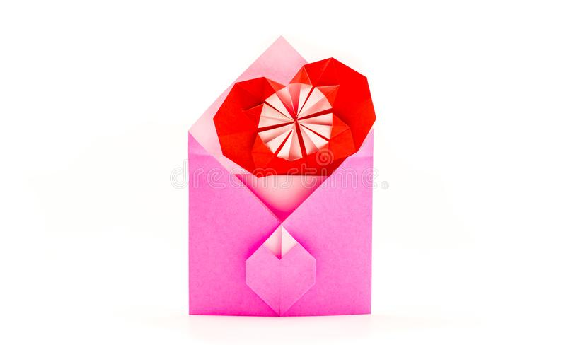 Pink origami envelope with red paper heart isolated on white royalty free stock photo