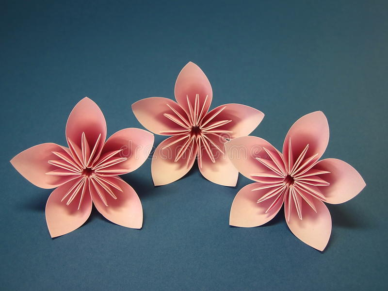 Pink origami flowers royalty free stock images