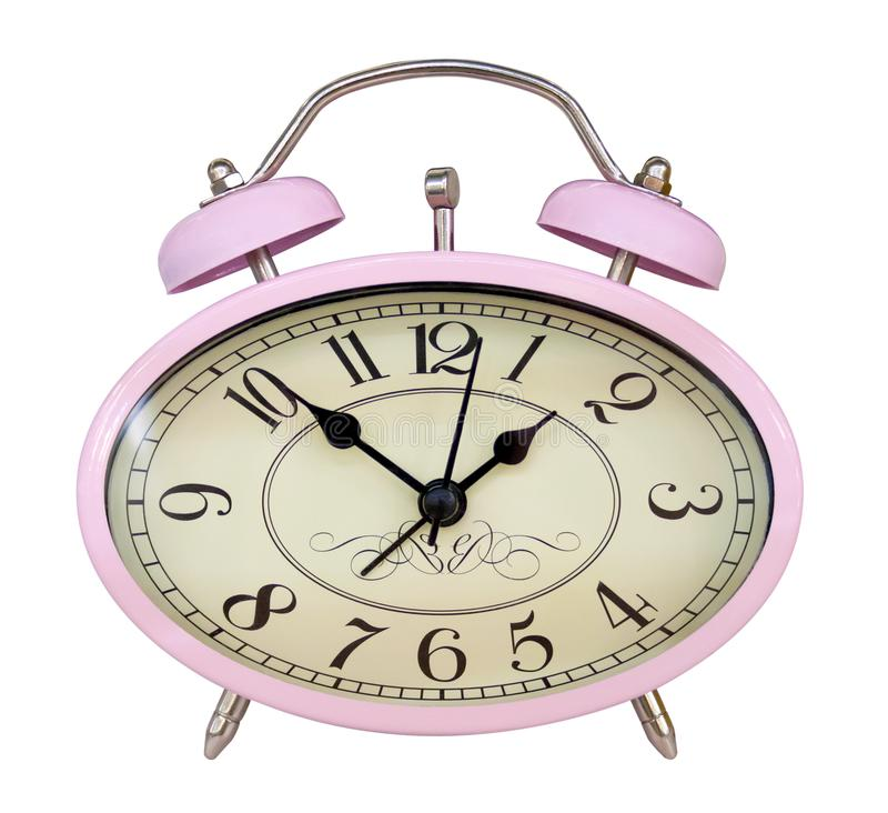 Pink oval alarm clock isolated on white stock photo