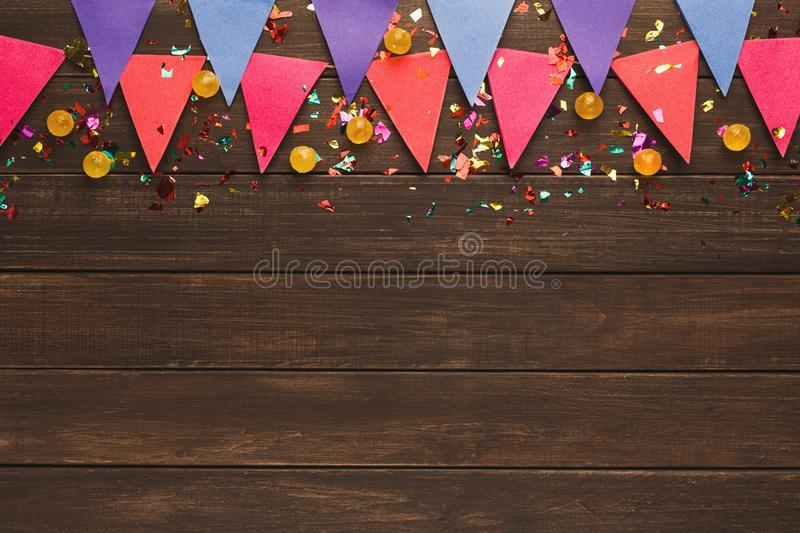 Colorful flags garland on wooden background stock images