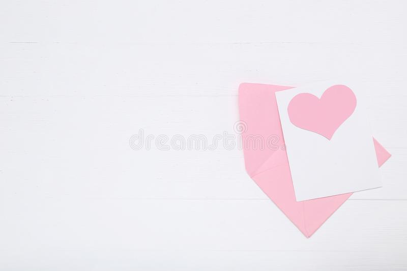 Paper heart with envelope. Pink paper heart with envelope on white background stock photography