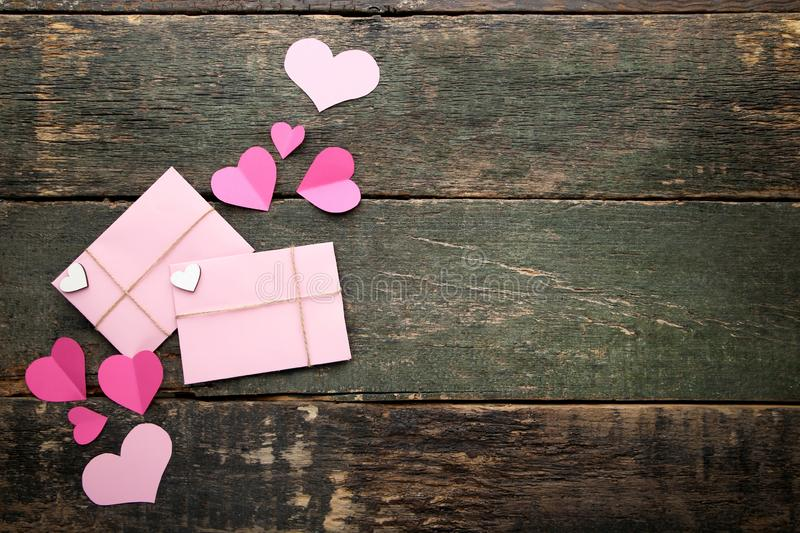 Pink paper hearts with envelopes stock image
