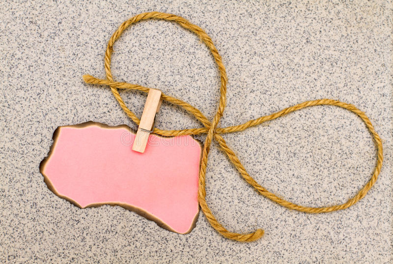 Pink paper for records on a clothespin stock images