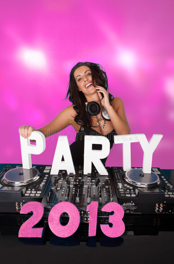 Pink PARTY 2013 with female DJ. Pink PARTY 2013 with vivacious female DJ laughing as she stands behind her music deck and turntables with copyspace royalty free stock photography