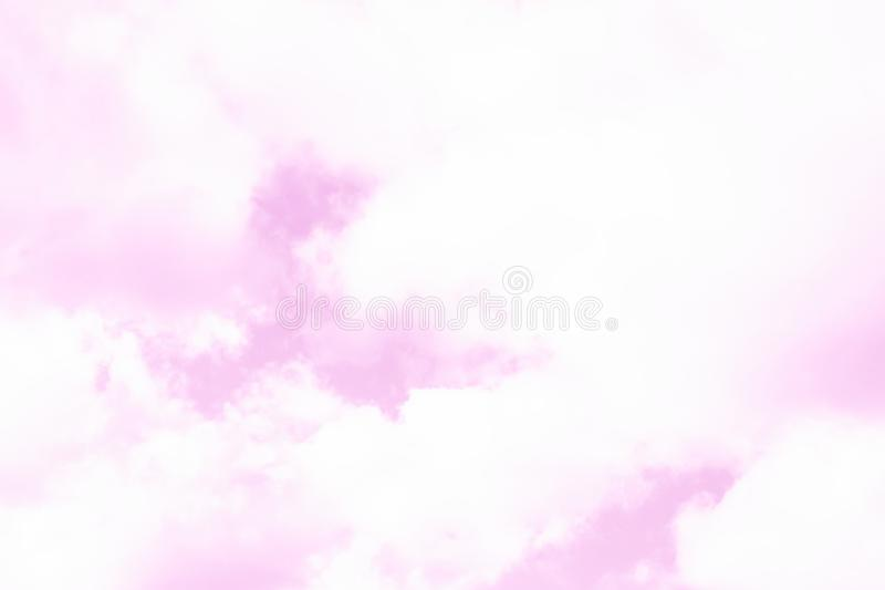 Pink pastel sky with fluffy white clouds. Looks like a marble texture stock photo