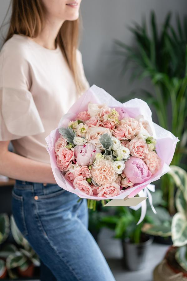 Pink peonies. Beautiful bouquet of mixed flowers in woman hand. Floral shop concept . Handsome fresh bouquet. Flowers royalty free stock images