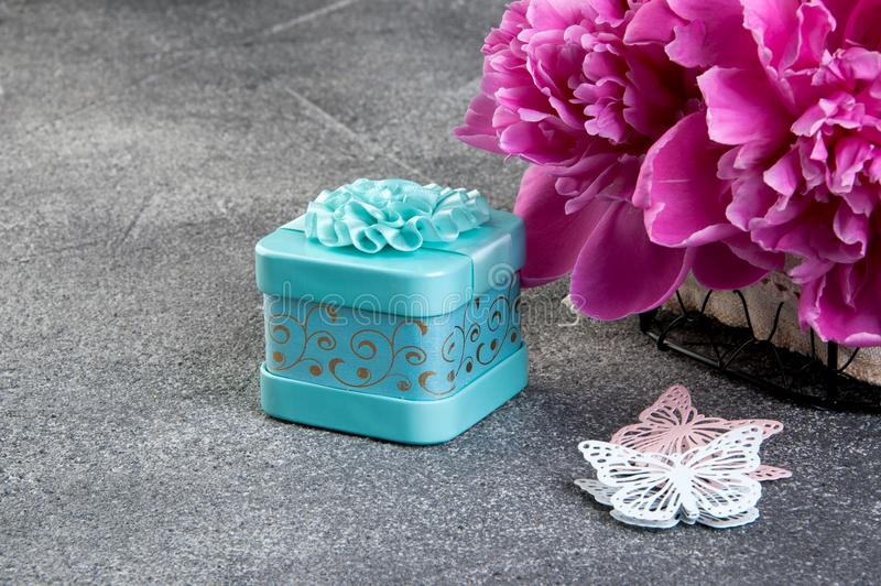 Pink peony, aquamarine gift box and butterflies royalty free stock photo