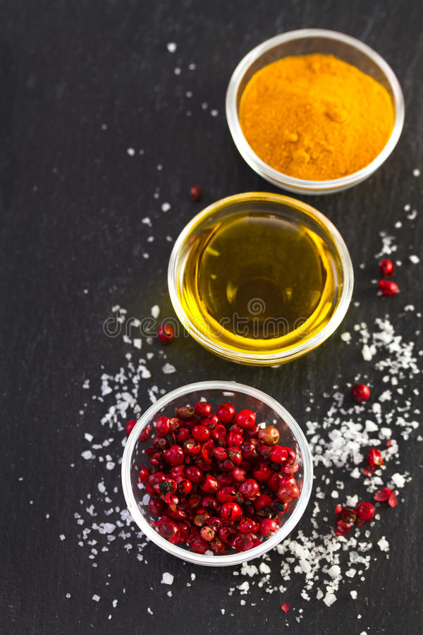 Pink pepper. With olive oil stock photos