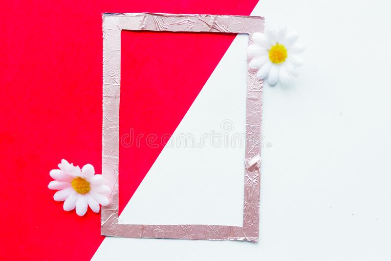 Pink photo frame on geometric red and white background decorative with flowers. Mother`s Day, Valentine`s Day on Women`s Day greeting card stock image