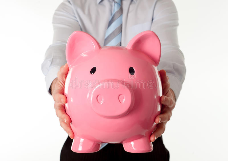 Pink Piggy Bank With Businessman In The Background Royalty Free Stock Image