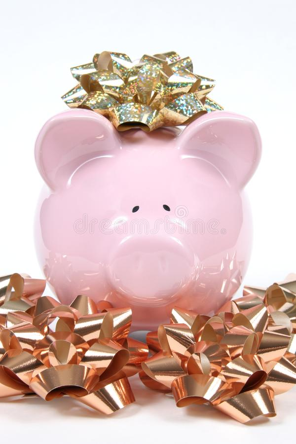 Pink Piggy Bank with Christmas bows stock image