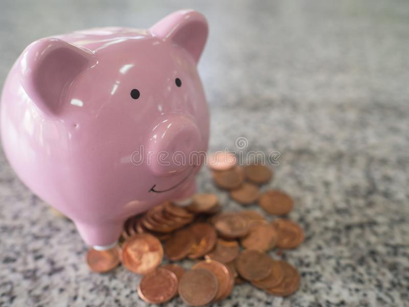 Pink piggy bank with coins pile, step up to start up business to success, Saving money for future plan and retirement fund concept royalty free stock photography