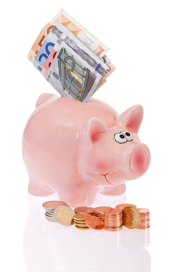 Pink Piggy Bank With Coins And Bills Stock Photography