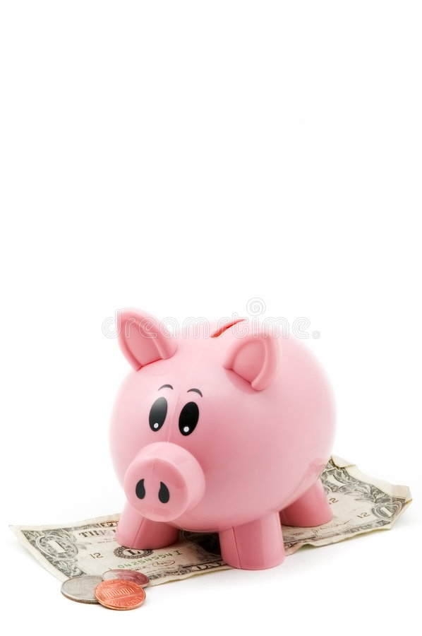 Pink Piggy Bank on Dollar with Change. Pink Piggy Bank standing on dollar bill looks down at change - isolated on white stock images