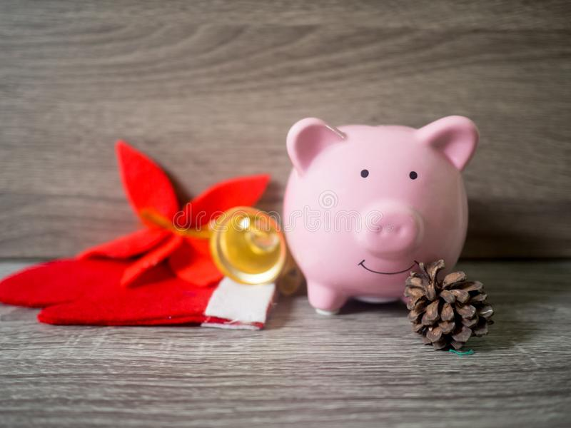 Pink piggy bank and pinecone with x`mas theme, Enjoy savings for the holidays concept.  royalty free stock photography