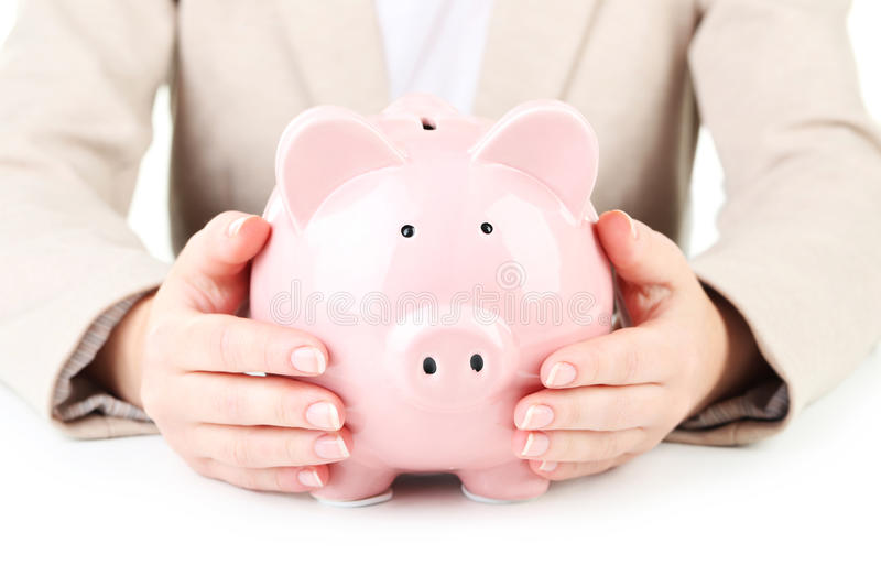 Pink piggy bank. Protected by hands royalty free stock images