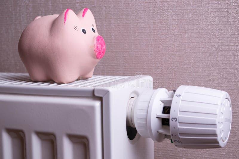 Pink piggy bank saving electricity and heating costs, close up stock photos