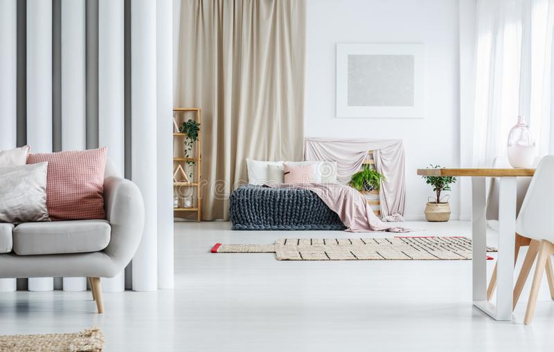 Spacious apartment with gold curtain stock images