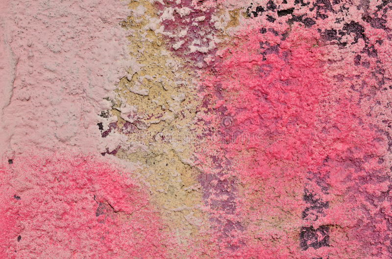 Pink plaster coating. Rough plaster coating airbrushed in pink hues stock photo