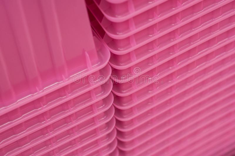 pink plastic boxes pile stock photography