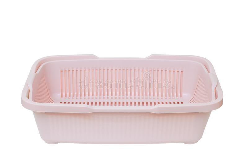 Pink plastic tray with cat litter box. White isolate stock photography