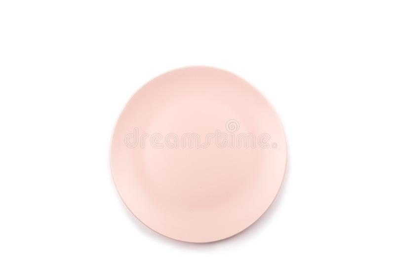 Pink plate isolated on white stock photo