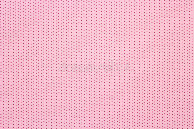 Pink polka dots pattern background, top view stock photo