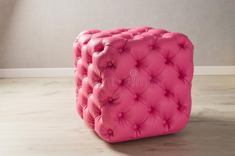 Sweet home. Leather pouf in the room royalty free stock images