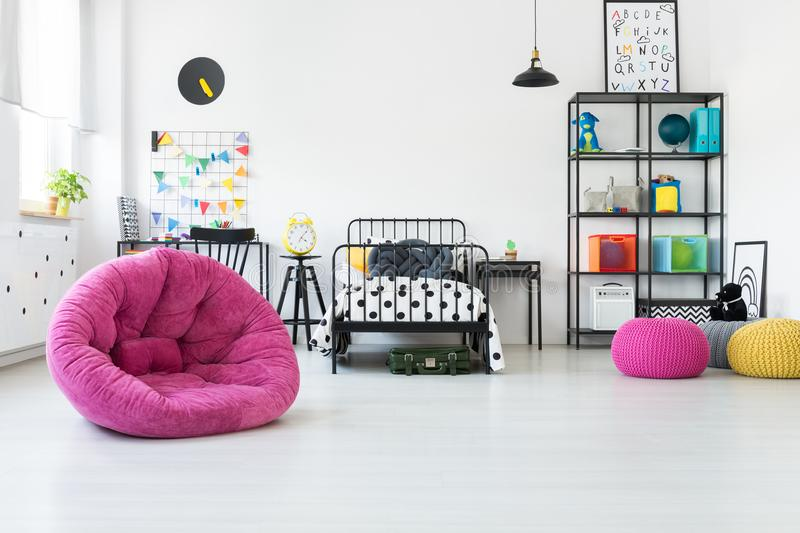 Pink pouf in kid`s room royalty free stock image
